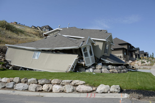 Al Hartmann  |  The Salt Lake Tribune  A home destroyed by landslide at Parkway Drive in North Salt Lake. Residents returned to their homes Wednesday Aug. 6, 2014, a day after a landslide destroyed the home and others had to be evacuated.