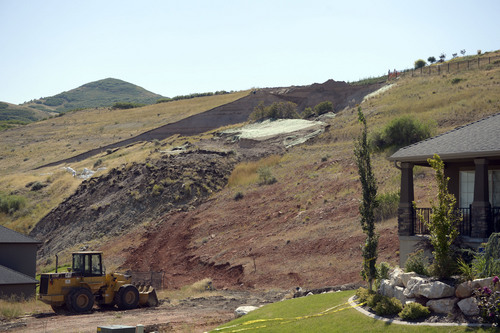 Al Hartmann  |  The Salt Lake Tribune  The scene of Tuesday's landslide.  Residents returned to their  homes along Parkway Drive in North Salt Lake Wednesday Aug. 6, 2014, a day after the  landslide destroyed a home and others had to be evacuated.