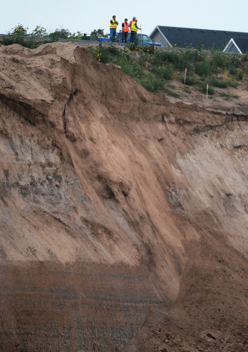 Steve Griffin  |  The Salt Lake Tribune   Authorities keep an eye on the side of a mountain in this North Salt Lake City, Utah neighborhood where heavy rains caused the mountain side to slide destroying a home Tuesday, August 5, 2014.