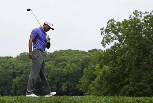 Tiger Woods react to a poor tee shot on the second hole during the first round of the PGA Championship golf tournament at Valhalla Golf Club on Thursday, Aug. 7, 2014, in Louisville, Ky. (AP Photo/John Locher)