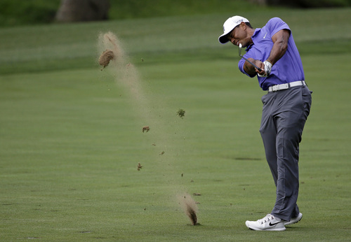 Tiger Woods hits from the fairway on the 15th hole during the first round of the PGA Championship golf tournament at Valhalla Golf Club on Thursday, Aug. 7, 2014, in Louisville, Ky. (AP Photo/John Locher)