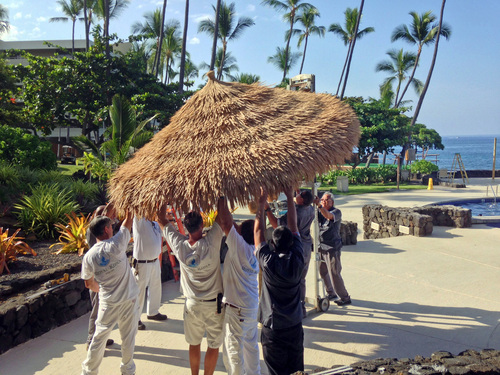 Staff members of the Royal Kona Resort in Kailua, Hawaii take down umbrellas as the resort prepares for Hurricane Iselle on Thursday, Aug. 7, 2014. Hurricane Iselle is expected to arrive on the Big Island on Thursday evening, bringing heavy rains, winds gusting up to 85 mph and flooding in some areas. Weather officials changed their outlook on the system Wednesday after seeing it get a little stronger, giving it enough oomph to stay a hurricane as it reaches landfall. (AP Photo/Chris Stewart)