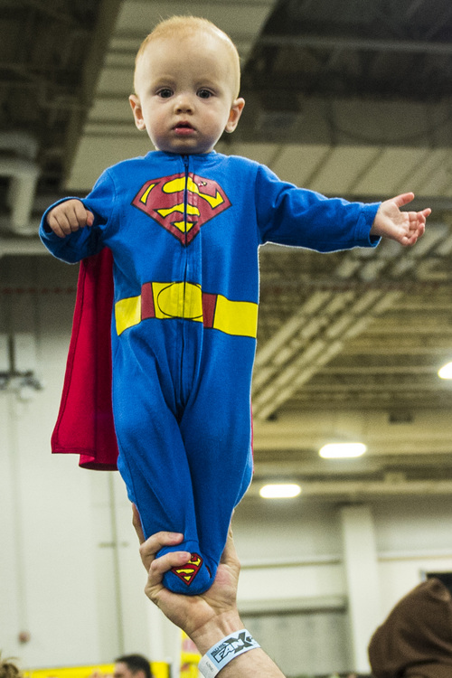 Chris Detrick  |  The Salt Lake Tribune Deacon Ely, 10 months, is dressed as Super Man at Salt Lake Comic Con FanXperience at the Salt Palace Convention Center Saturday April 19, 2014.
