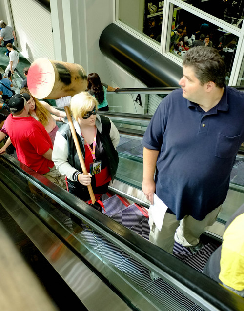 Trent Nelson  |  The Salt Lake Tribune Characters ride the escalator at Salt Lake Comic Con in Salt Lake City Saturday, September 7, 2013.
