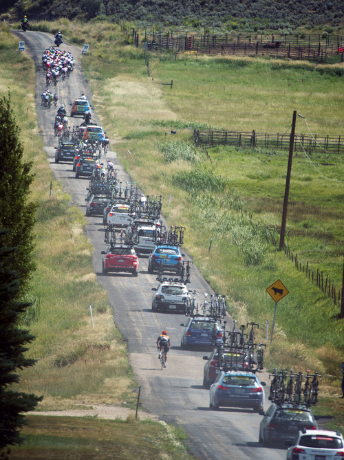 Steve Griffin  |  The Salt Lake Tribune   Dust rises through the air as riders and their support vehicles finish a two-mile stretch of dirt road on their way to the finish line in Kamas, Utah Friday, August 8, 2014 during the fifth stage of the event.  Riders road between Evanston and Kamas  two gateway cities to the High Uintas Wilderness and beautiful Mirror Lake Scenic Byway.