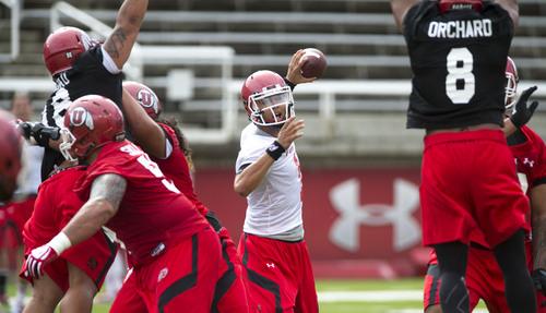 Steve Griffin  |  The Salt Lake Tribune  Utah quarterback Kendal Thompson looks to pass during football practice at Rice-Eccles Stadium in Salt Lake City Monday, Aug. 4, 2014.