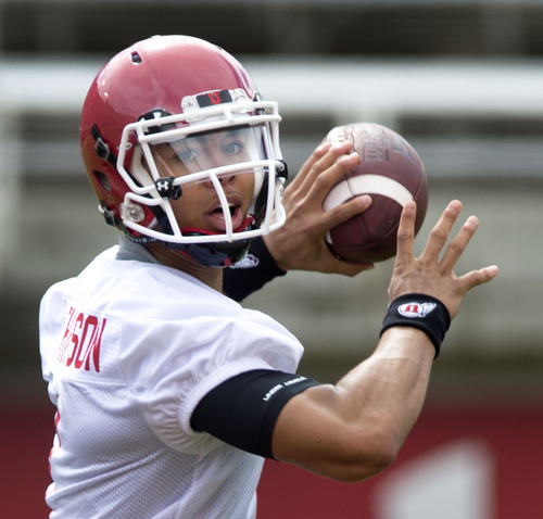 Steve Griffin  |  The Salt Lake Tribune  Utah quarterback Kendal Thompson looks to pass during football practice at Rice-Eccles Stadium in Salt Lake City Monday, Aug. 4, 2014.