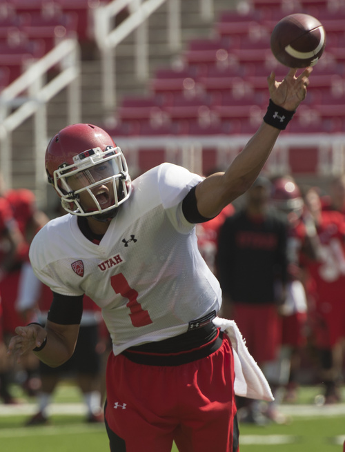 Rick Egan  |  The Salt Lake Tribune  Ute QB, Kendal Thompson throws a pass during practice at Rice Eccles Stadium, Wednesday, August 6, 2014