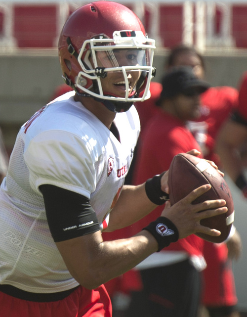 Rick Egan  |  The Salt Lake Tribune  Ute QB, Kendal Thompson looks for an open man, during practice at Rice Eccles Stadium, Wednesday, August 6, 2014