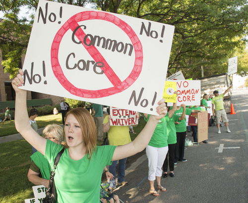 Rick Egan  |  The Salt Lake Tribune  Holly Jorgensen, Roy, chants with a group of protestors against Utah's Common Core outside the the Utah Office of Education, Friday, August 8, 2014
