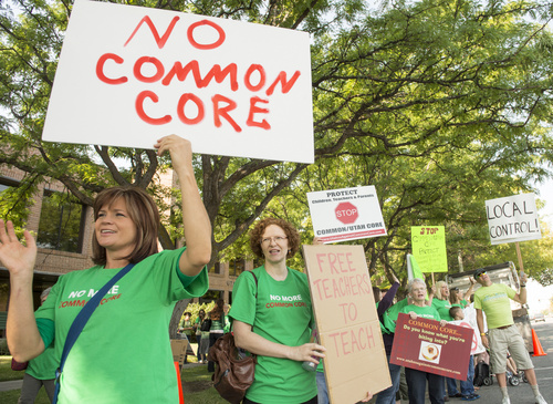 Rick Egan  |  The Salt Lake Tribune  Opponents of Utah's Common Core protest  outside the State Board of Education meeting, Friday, August 8, 2014