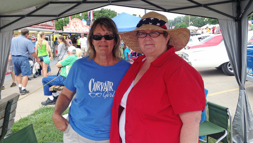 In this Aug. 8, 2014 photo Mary Oberembt, of West Des Moines, and Teresa Miller, of Des Moines, attend the Iowa State Fair in Des Moines. Both think the United States should not have pulled troops out of Iraq. (AP Photo/Catherine Lucey)