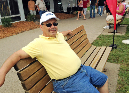 In this Aug. 8, 2014 photo Doyle Ellis, of New Virginia, Iowa, attends the Iowa State Fair in Des Moines. The post office worker thinks going into Iraq is the right thing to do, but the United States should be there as peacekeepers. (AP Photo/Catherine Lucey)