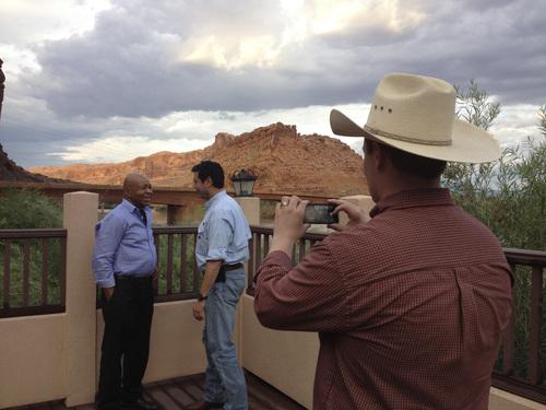 Matt Canham  |  The Salt Lake Tribune  Rep. Elijah Cummings, D-Md., asks Rep. Jason Chaffetz, R-Utah, to pose in a photo, handing his iPhone to Chaffetz' staffer Colton Miles.
