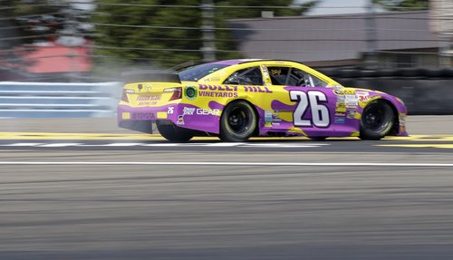 Cole Whitt (26) runs off the course during a NASCAR Sprint Cup Series auto race at Watkins Glen International, Sunday, Aug. 10, 2014, in Watkins Glen N.Y. (AP Photo/Mel Evans)