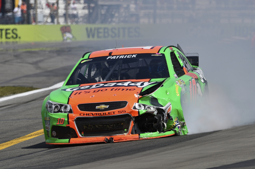 Danica Patrick (10) drives her wrecked race car during a NASCAR Sprint Cup Series auto race at Watkins Glen International, Sunday, Aug. 10, 2014, in Watkins Glen N.Y. (AP Photo/Derik Hamilton)