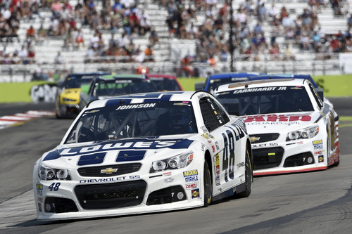 Jimmie Johnson (48) leads Dale Earnhardt Jr. (88) and others during a NASCAR Sprint Cup Series auto race at Watkins Glen International, Sunday, Aug. 10, 2014, in Watkins Glen N.Y. (AP Photo/Derik Hamilton)