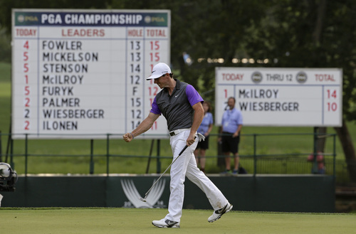 Rory McIlroy, of Northern Ireland, celebrates a putt on the 13th hole during the final round of the PGA Championship golf tournament at Valhalla Golf Club on Sunday, Aug. 10, 2014, in Louisville, Ky. (AP Photo/Jeff Roberson)