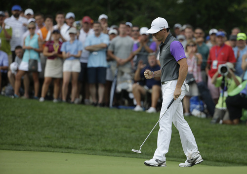 Rory McIlroy, of Northern Ireland, celebrates his eagle on the 10th hole during the final round of the PGA Championship golf tournament at Valhalla Golf Club on Sunday, Aug. 10, 2014, in Louisville, Ky. (AP Photo/Jeff Roberson)