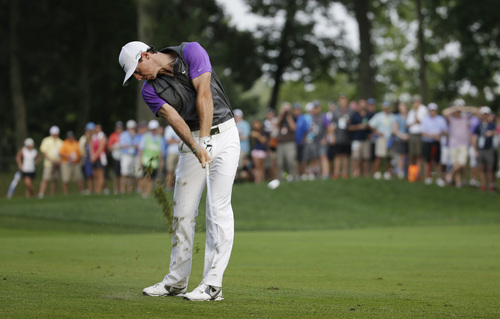 Rory McIlroy, of Northern Ireland, hits from the fairway on the 12th hole during the final round of the PGA Championship golf tournament at Valhalla Golf Club on Sunday, Aug. 10, 2014, in Louisville, Ky. (AP Photo/Jeff Roberson)