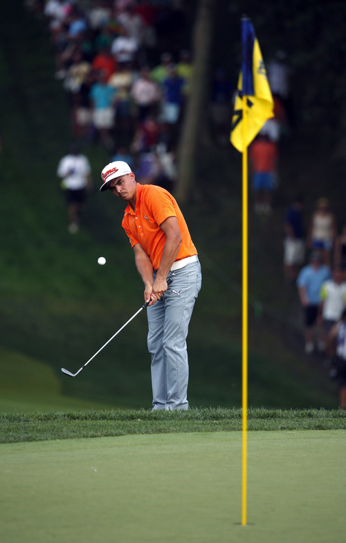 Rickie Fowler chips to 12th hole during the final round of the PGA Championship golf tournament at Valhalla Golf Club on Sunday, Aug. 10, 2014, in Louisville, Ky. (AP Photo/Mike Groll)
