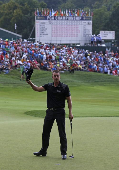 Henrik Stenson, of Sweden, waves to the crowd on the 18th hole during the final round of the PGA Championship golf tournament at Valhalla Golf Club on Sunday, Aug. 10, 2014, in Louisville, Ky. (AP Photo/John Locher)