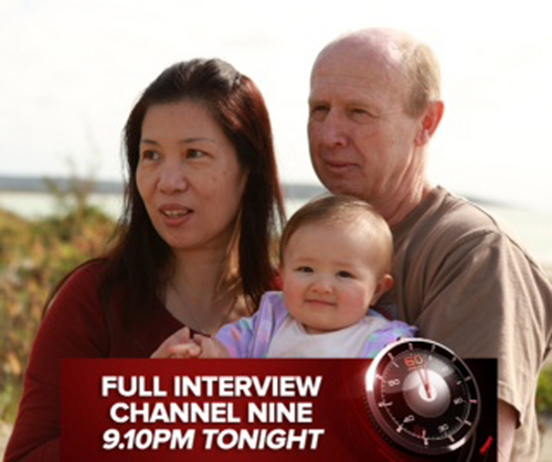 "In this image taken from video supplied Sunday, Aug. 10, 2014 by Channel 9's ""60 Minutes"",  David Farnell, right, his wife Wendy, left, pose with theyir baby Pipah in Australia. The Australian couple, David and his wife Wendy Farnell,  has denied that they abandoned their son born with Down syndrome to a Thai surrogate. The couple said in the interview that the boy's surrogate mother, Pattaramon Chanbua, insisted she be allowed to keep the boy and that she threatened to also keep his twin sister Pipah. (AP Photo/Channel 9 60 Minutes)  AUSTRALIA OUT, NO SALES, EDITORIAL USE ONLY"