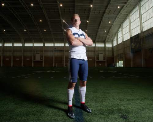 Chris Detrick  |  The Salt Lake Tribune Brigham Young Cougars quarterback Taysom Hill (4) during a practice at Richards Building Fields Friday August 1, 2014.