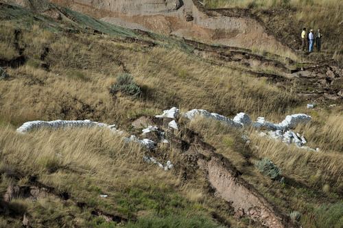 Jeremy Harmon  |  The Salt Lake Tribune  Sandbags are seen on the hillside above 739 Parkway Drive in North Salt Lake where a home was destroyed by a landslide early in the morning on Tuesday, August 5, 2014.