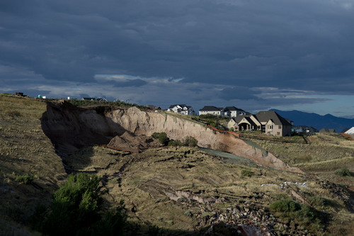 Jeremy Harmon  |  The Salt Lake Tribune  This hillside gave way early in the morning and destroyed a home at 739 Parkway Drive in North Salt Lake on Tuesday, August 5, 2014.