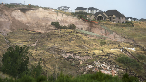 Steve Griffin  |  The Salt Lake Tribune   North Salt Lake City, Utah neighborhood where heavy rains caused the mountain side to slide destroying a home Tuesday, August 5, 2014.