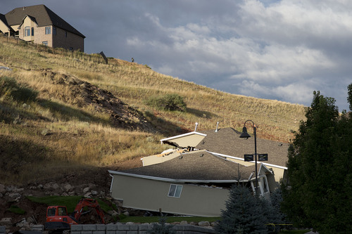 Jeremy Harmon  |  The Salt Lake Tribune  This home at 739 Parkway Drive in North Salt Lake was destroyed by a landslide early in the morning on Tuesday, August 5, 2014.