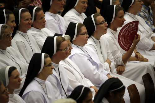 A nun waves her fan as she attends Pope Francis' weekly general audience in the Paul VI hall, at the Vatican, Wednesday, Aug. 6, 2014. (AP Photo/Andrew Medichini)
