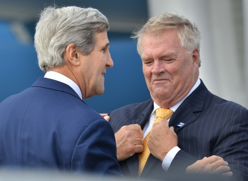 U.S. Secretary of State John Kerry, left, meets with Kim Beazley, Australian Ambassador to the United States, as Kerry arrives in Sydney, Monday, Aug. 11, 2014. Kerry and US Secretary of Defense Chuck Hagel are in Sydney for the annual Australia-United States Ministerial (AUSMIN) talks. (AP Photo/Peter Parks, Pool)