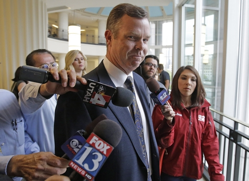 Former Utah Attorney General John Swallow arrives at court for his initial court appearance on bribery charges, Wednesday, July 30, 2014, in Salt Lake City. Swallow and former Utah Attorney General Mark Shurtleff made their first appearance as criminal defendants Wednesday, vowing to beat bribery charges and other counts. (AP Photo/Rick Bowmer)