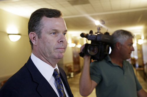 Former Utah Attorney General John Swallow leaves court after making his initial court appearance on bribery charges, Wednesday, July 30, 2014, in Salt Lake City. Swallow and former Utah Attorney General Mark Shurtleff made their first appearance as criminal defendants Wednesday, vowing to beat bribery charges and other counts. (AP Photo/Rick Bowmer)