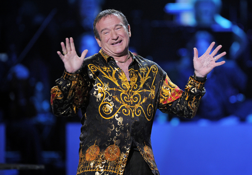 """FILE - This April 6, 2008 file photo shows actor-comedian Robin Williams speaks on stage at the """"Idol Gives Back"""" fundraising special of """"American Idol"""" in Los Angeles. Williams, whose free-form comedy and adept impressions dazzled audiences for decades, has died in an apparent suicide. He was 63. The Marin County Sheriff's Office said Williams was pronounced dead at his home in California on Monday, Aug. 11, 2014. The sheriff's office said a preliminary investigation showed the cause of death to be a suicide due to asphyxia. (AP Photo/Mark J. Terrill, File)"""