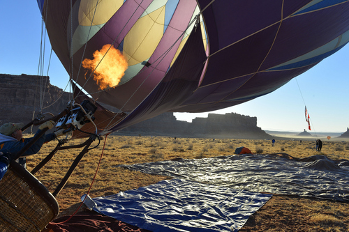 Keith Johnson | The Salt Lake Tribune  Ogden, Utah resident Matt McClary prepares his hot air balloon Midnight Blue to launch in the Valley of the Gods in Southeastern Utah on the last day of the16th annual Bluff Balloon Festival outside Bluff, Utah January 19, 2014.