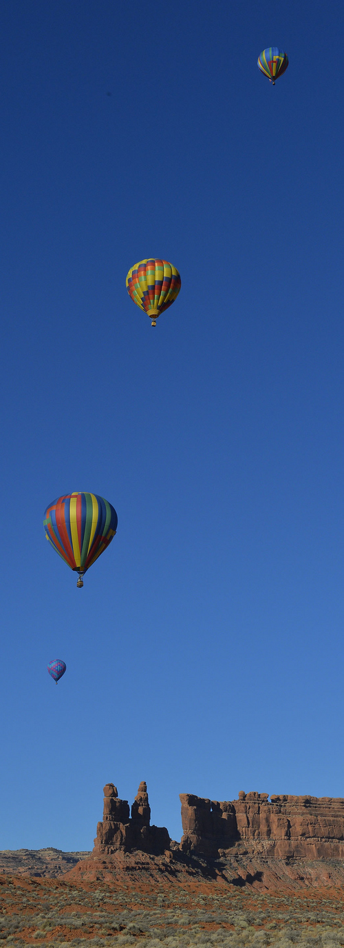 Keith Johnson | The Salt Lake Tribune  Hot air balloons fly over the Valley of the Gods in Southeastern Utah on the last day of the16th annual Bluff Balloon Festival outside Bluff, Utah January 19, 2014.