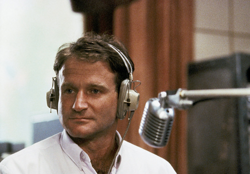 "FILE - This 1987 file photo released by Touchstone Pictures shows actor Robin Williams in character as disc-jockey Adrian Cronauer in director Barry Levinsons comedy drama, ""Good Morning Vietnam."" Williams, whose free-form comedy and adept impressions dazzled audiences for decades, has died in an apparent suicide. He was 63. The Marin County Sheriff's Office said Williams was pronounced dead at his home in California on Monday, Aug. 11, 2014. The sheriff's office said a preliminary investigation showed the cause of death to be a suicide due to asphyxia. (AP Photo/Touchstone Pictures)"