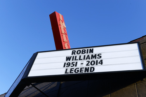 The marquee of the Improv is photographed with a message in memory of actor Robin Williams in the Hollywood district of Los Angeles Monday, Aug. 11, 2014. Williams, the Academy Award winner and comic supernova whose explosions of pop culture riffs and impressions dazzled audiences for decades died Monday in an apparent suicide at his San Francisco Bay area home. He was 63. (AP Photo/Kevork Djansezian)