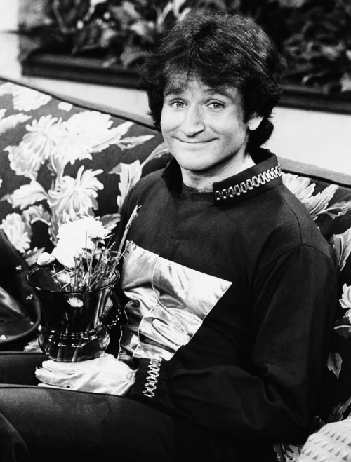 "FILE - This 1978 file photo originally released by ABC shows actor Robin Williams on the set of ABCs ""Mork and Mindy."" Williams, whose free-form comedy and adept impressions dazzled audiences for decades, has died in an apparent suicide. He was 63. The Marin County Sheriff's Office said Williams was pronounced dead at his home in California on Monday, Aug. 11, 2014. The sheriff's office said a preliminary investigation showed the cause of death to be a suicide due to asphyxia. (AP Photo/ABC, File)"