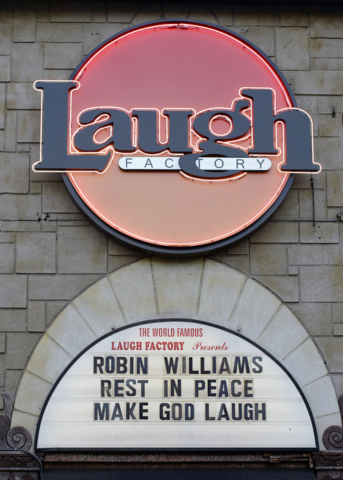 The marquee of the Laugh Factory shows a message in memory of actor/comedian Robin Williams in the Hollywood district of Los Angeles Monday, Aug. 11, 2014. Williams, the Academy Award winner and comic supernova whose explosions of pop culture riffs and impressions dazzled audiences for decades and made him a gleamy-eyed laureate for the Information Age, died Monday in an apparent suicide at his San Francisco Bay area home. He was 63. (AP Photo/Kevork Djansezian)