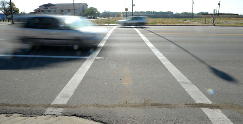Steve Griffin  |  The Salt Lake Tribune  A crosswalk was installed at the intersection of Wall Avenue and Binford Avenue last year in Ogden, as shown on Wednesday, Aug. 6, 2014. Several pedestrians have been hit on Wall Avenue while trying to cross the five-lane road between 26th and 27th streets.