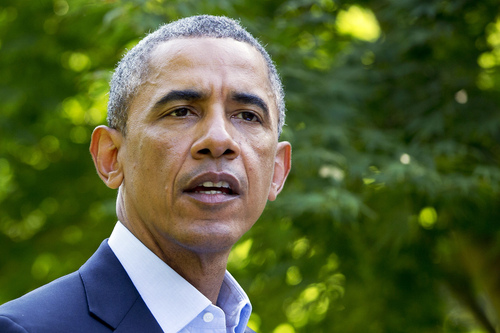 President Barack Obama speaks about developments in Iraq, Monday, Aug. 11, 2014, in Chilmark, Mass., during his family vacation on the island of Martha's Vineyard.   (AP Photo/Jacquelyn Martin)
