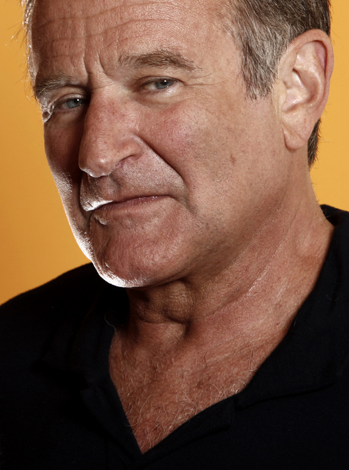 """FILE - This Aug. 14, 2009 file photo shows actor Robin WIlliams from the film """"World's Greatest Dad"""" in Los Angeles. Williams, whose free-form comedy and adept impressions dazzled audiences for decades, has died in an apparent suicide. He was 63. The Marin County Sheriff's Office said Williams was pronounced dead at his home in California on Monday, Aug. 11, 2014. The sheriff's office said a preliminary investigation showed the cause of death to be a suicide due to asphyxia. (AP Photo/Matt Sayles, File)"""