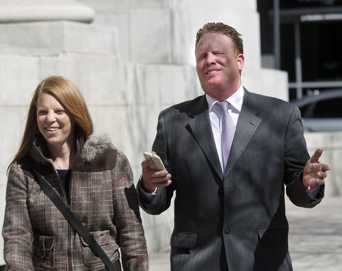 Al Hartmann  |  The Salt Lake Tribune Jeremy Johnson and wife Sharla smile and say that they can't say anything to the media after leaving Federal Court in Salt Lake City Wendesday April 10 for his initial appearance on an indictment on conspiracy, fraud and money laundering in connection to  I Works company.