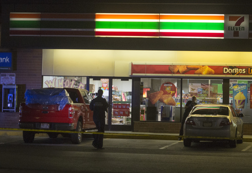 Rick Egan  |  The Salt Lake Tribune Salt Lake police investigate a shooting at the 7-Eleven on 2100 South and State Street,  Monday, August 11, 2014