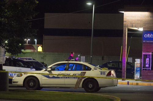 Rick Egan     The Salt Lake Tribune  Salt Lake police investigate a shooting at the 7-Eleven on 2100 South and State Street,  Monday, August 11, 2014