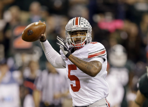FILE - In this Dec. 7, 2013, file photo, Ohio State quarterback Braxton Miller throws a pass against Michigan State during the Big Ten Conference championship NCAA college football game in Indianapolis. Despite missing nearly three full games with a sprained knee last season, he passed for 2,094 yards and 24 touchdowns, and ran for 1,068 yards and 12 scores.  (AP Photo/Michael Conroy, File)